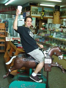 Louis rides a horsey in the peanut shop!
