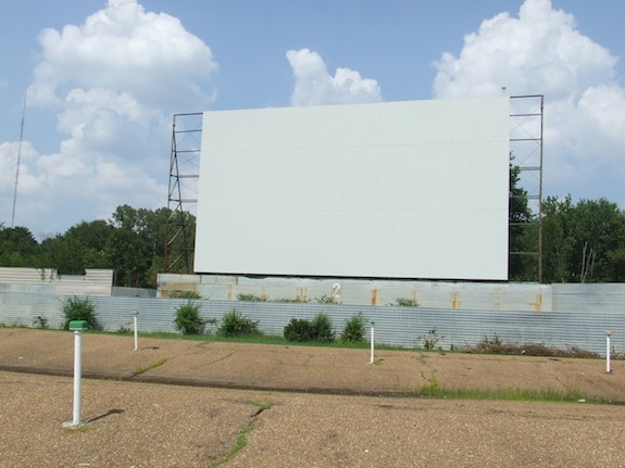 "This particular drive in cinema screen caught fire and had to be restored.  Even with new screen material, it is impossible for a drive in screen to look ""modern.""  And that's a good thing."
