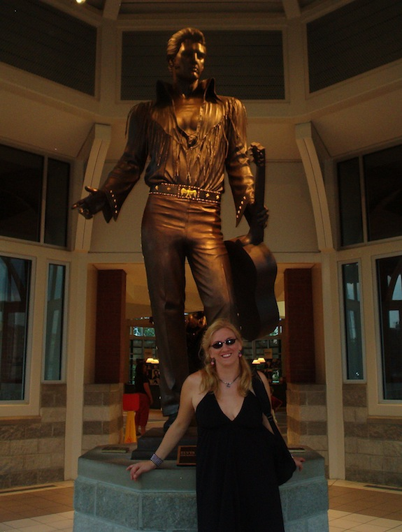 Char stands in front of an Elvis Presley statue at a Memphis Welcome Center.