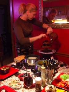 Char pours the chocolate into the chocolate fountain.