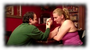 Char and Louis prepare to face off in arm wrestling