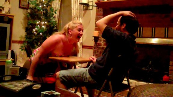 Char celebrates her victory in the arm wrestling rematch.