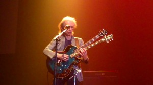 Steve Howe playing two guitars during Roundabout