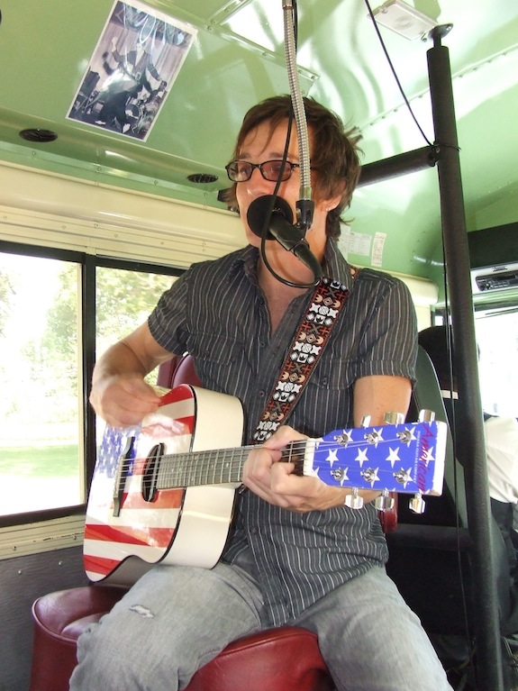 Memphis Jones entertains an audience during one of his bus tours.