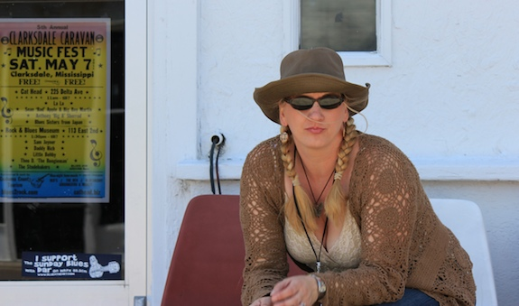 Char sits outside Blues Town Music in Downtown Clarksdale