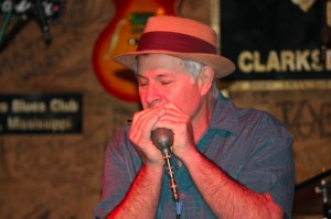 Stan Street blowing the blues harp.