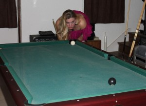 Char studies her shot during the final moments of the 8 ball game...