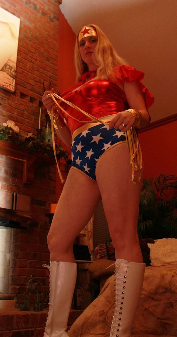 Char in her Wonder Woman costume.  She's getting ready for this year's Paper Football Championship Bowl Game - this year to be played in costume!