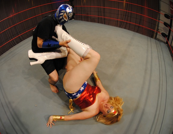The intimidating wrestling mask appears to give Louis a little more confidence against Wonder Woman in this match!