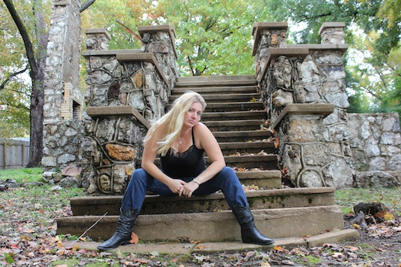 Char Magnifico on the steps of a house that has been torn down in Hardy Arkansas