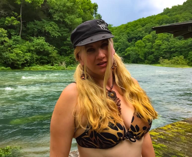 Char in bikini on the river