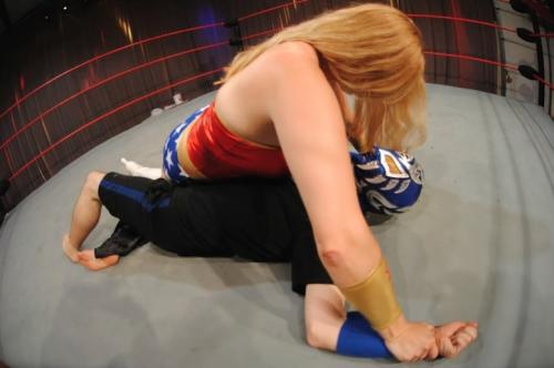 Char pins Louis during a costumed match in Arkansas